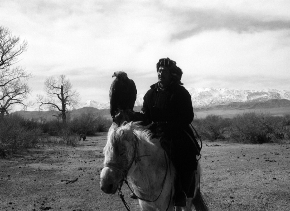 Hunter and eagle on horseback